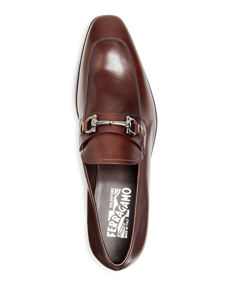 From Salvatore Ferragamo, these slip-on loafers feature a signature Gancini bit for a simple and sophisticated twist on a classic.   Leather/rubber   Made in Italy   Fits true to size, please order no