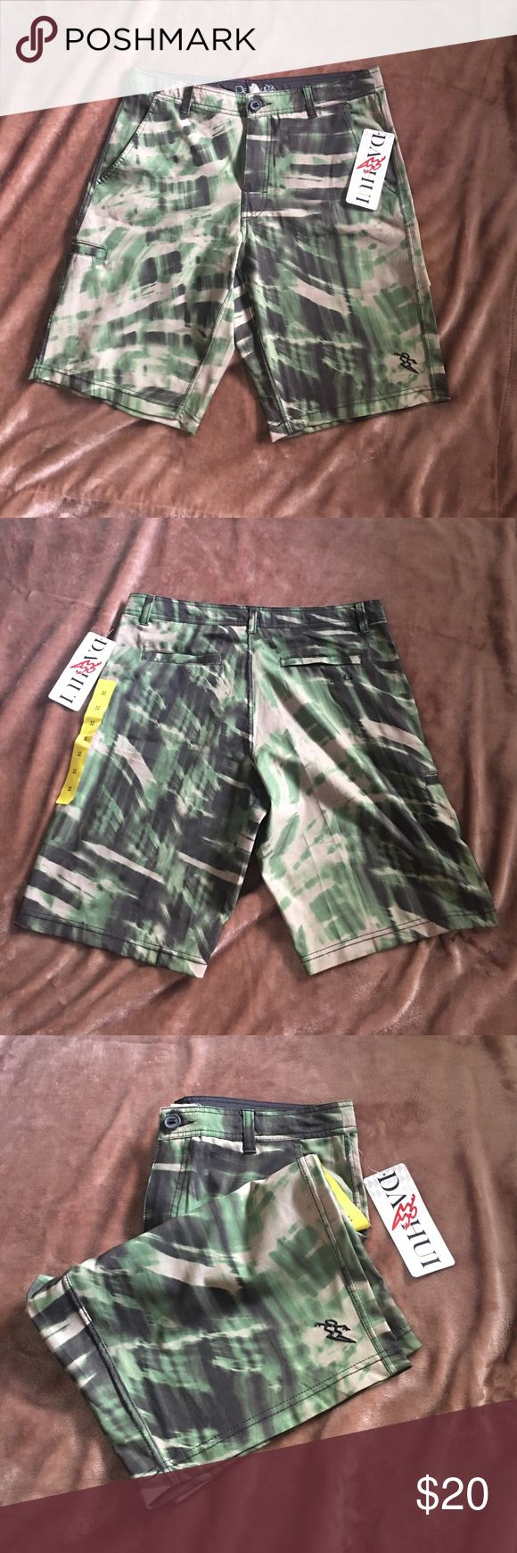 """Surf shorts These shorts can be used to swim or just be worn as casual shorts. Have pockets on the side and back. Belt loops and button and zipper closure. Also has drawstring on inside. Brand new with tags. No flaws. """"Da Hui"""" brand, listed as Volcom for exposure Volcom Shorts Hybrids"""