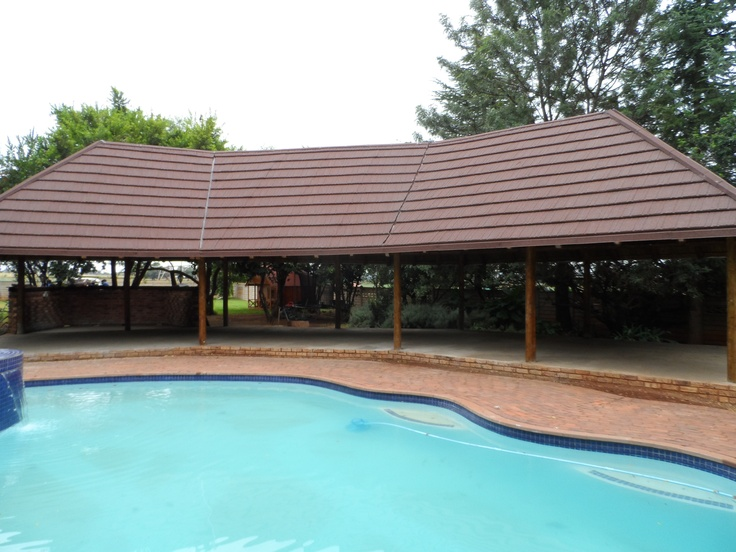 Relax at your pool under a maintenance free, Woodshake, thatch alternative roof