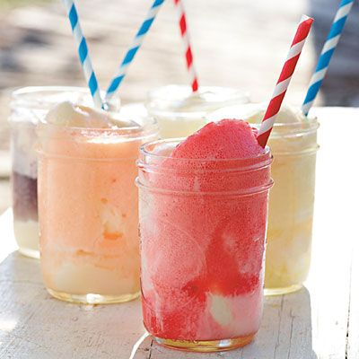 Fizzy, Fruity Ice-cream Floats: Let guests pour their favorite fruit-flavored soft drinks (such as grape, lime, or black cherry) over scoops of vanilla ice cream. Striped straws add a retro touch (greenpartygoods.com or jackandlulu.com). | SouthernLiving.com | #4thofJuly