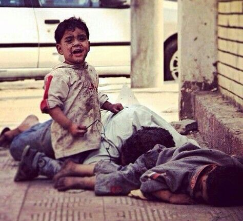 Save Syria A Little Boy Cries Next To His Dead Brother