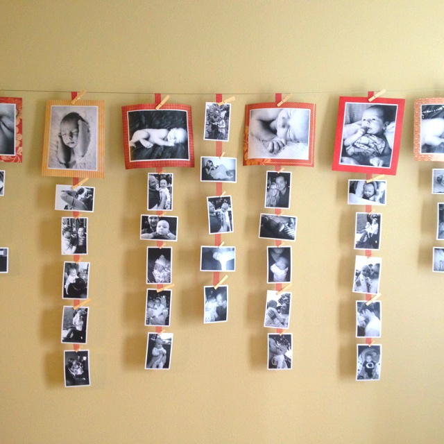photos hanging from ribbon with clothes pins photo