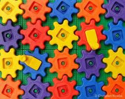 These little plastic toys connect together like a jigsaw puzzle. This is a temporary connection as it can be taken apart very easily. because of their shape they slot into each other with a click then they are simply just pulled apart.