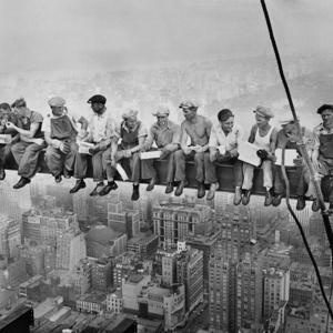 NERVES OF STEEL: This famous photo from 1932 shows a group of fearless ironworkers enjoying a break while building what's now the GE Building in Rockefeller Center.