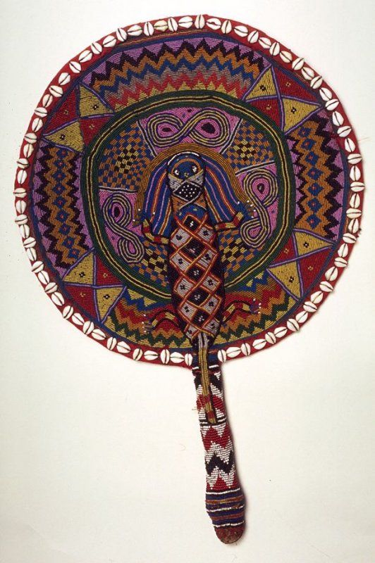 Ceremonial fan for Oshun Date: Early 20th century Location: Not on display Century: 20th Century AD Media: Cloth, Beads, And Cowrie Shells Dimensions: 22 1/4 x 14 1/2 (56.5 x 36.8 cm) Department: Africa, Oceania, and the Americas Object Type: Costume Country: Nigeria Continent: Africa Culture/People: Yoruba People
