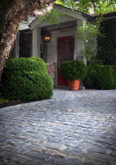 We love the way our Old World pavers give this driveway a cobblestone look.
