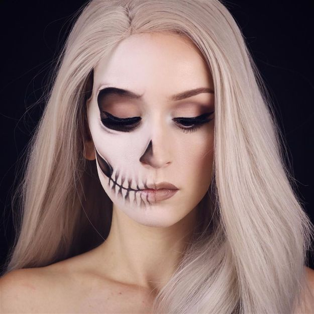 Photograph called: Half Skull Image via: kaylahagey  This image is a simple image, but the use of makeup is the main concept in this image. The illusion of life and death is a connotation to my theme of 'Light and Dark'.  https://makeuptutorials.com/spooky-scary-skeleton-makeup-halloween/