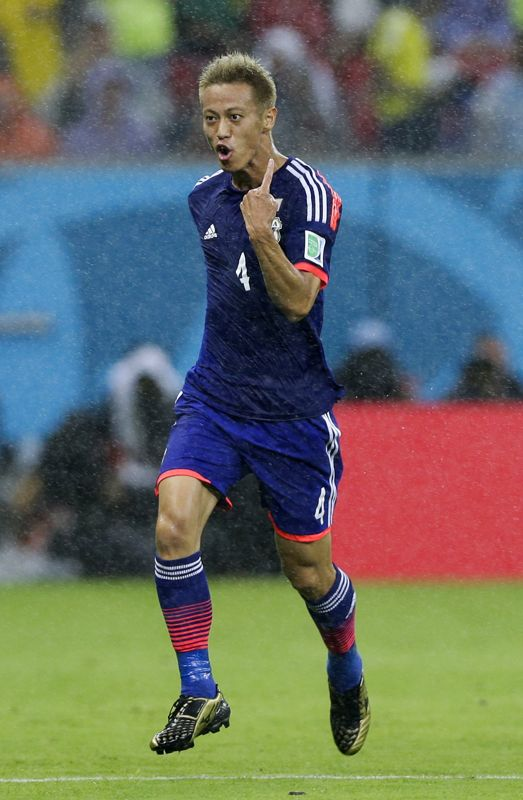 Japan's Keisuke Honda celebrates after scoring the opening goal during the group C World Cup soccer match between Ivory Coast and Japan at the Arena Pernambuco in Recife, Brazil, Saturday, June 14, 2014