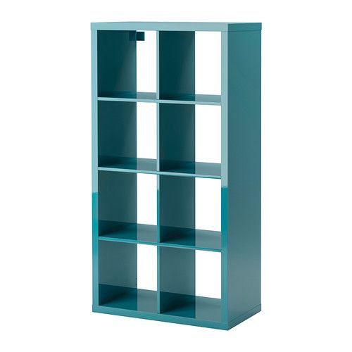 KALLAX Shelving unit IKEA The high gloss surfaces reflect light and give a vibrant look. On it's side- to use as a storage/sideboard piece? :)