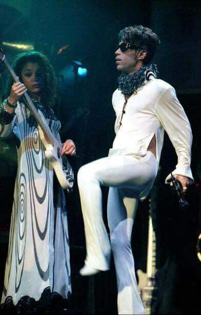 Prince in an awesone white outfit! No one - male or female - could wear clothes like Prince! I'm jealous!
