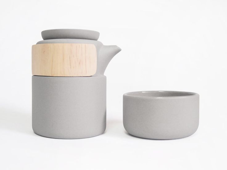 A modern tea pot made of ceramic and wood that has a simple, soothing effect on the eyes, which echoes the very beverage that it has been designed to serve.