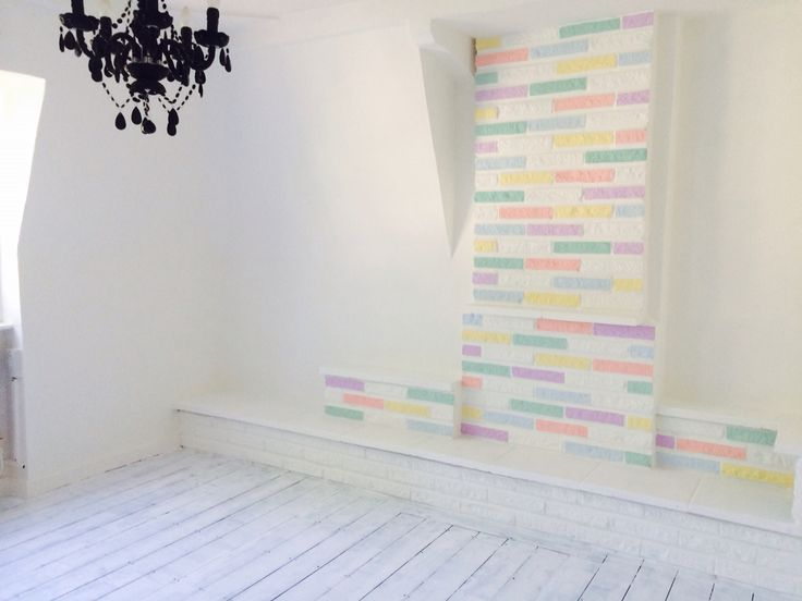 Multicoloured bricks, 1st coat white floor  #painted #brick #pastel #mint #coral #yellow #blue #lavender #white floorboards