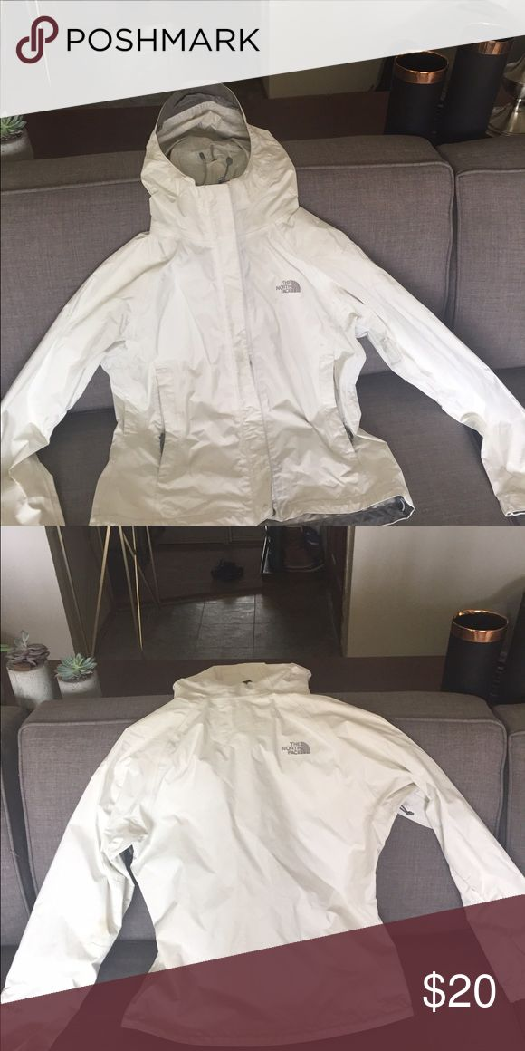 North face women's rain jacket The North Face women's rain jacket in white with gray detail. Has good, air vents and zip and Velcro closure. Has some wear but still works great to keep you dry and warm on hikes and walks in windy and wet weather. Size XS. North Face Jackets & Coats