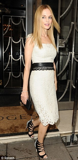 Mixing it: The stars dress featured both leather and lace and fitted her perfectly