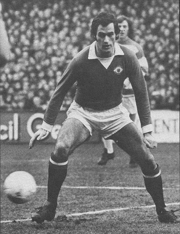 1st September 1973. Manchester United and Scotland midfielder George Graham in action against Queens Park Rangers, at Loftus Road.