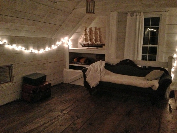 The upstairs of the guest house is completely open concept. This room has original floors (refinished) and ample space for a large bed and sitting area.