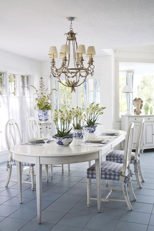 ... beach house dining room design, and the greenery gives it even more