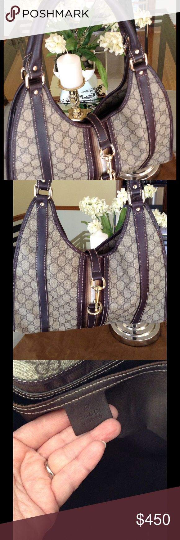 """GUCCI Authentic Bardot Handbag Authentic GUCCI beige/ebony coated signature GG Bardot handbag. Features gold-tone hardware with """"GUCCI"""" logo. Dark brown leather trim accents with a top strap closure. Dark brown canvas inside with pocket. Includes GUCCI dust bag. Dimensions are 15 x 12 x 4. Straps are 10"""" drop approx. Normal wear. Gucci Bags Hobos"""