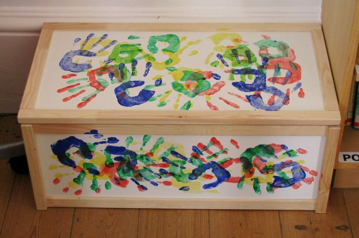 Plain IKEA toy box, decorated with hand prints. Makes the perfect storage / book box / Kinderbox for school! Rule was four hand prints of each colour on each surface.