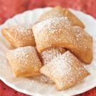 Try the Sopaipillas Recipe on williams-sonoma.com  This basic recipe is perfect with black coffee any time of day.