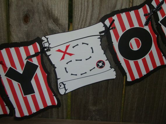 Pirate Inspiration: Ahoy, me Hearties!  Ye could easily make a pirate banner using a Cricut machine to hang from your crow's nest.