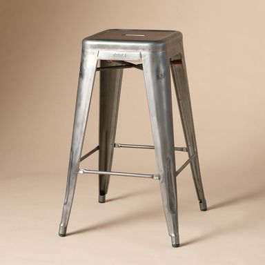 "MID CENTURY STUDIO STOOL -- Building on their reputation for innovative industrialized furnishings, the Burgundy-based manufacturer of our 1934 Dining Chairs introduced their stackable and stunning steel stools in 1950. Varnished to preserve the individual variations of the metal. Made in France by Tolix™. Add a coat of lacquer for outdoor use. 17-1/4"" Sq. x 27-1  $195"