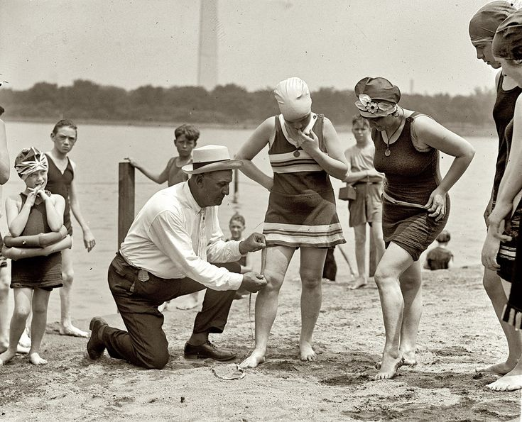 1922 beach police.  Law, no swimsuit higher than 6 inches above the knee.