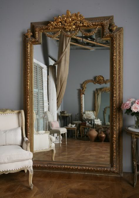 The patina of the wood and the gold gilt easily enhance a formal decor or become the focal point of a casual space. I love the visual surprise of pairing stand out formal furniture or accent pieces with casual or primitive design.