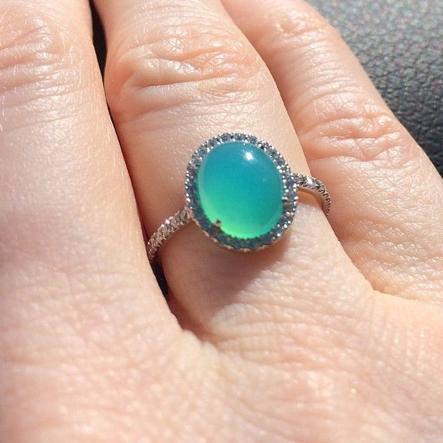 No filter. This luminescent Peruvian blue opal is of such great quality it looks like the waters in the Caribbean. An alternative to the diamond, this engagement ring is surrounded with white diamond micro pave.
