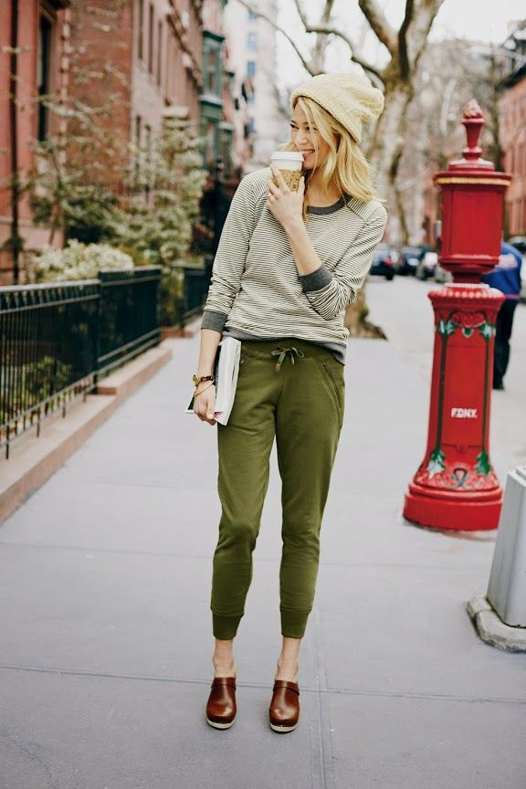 Consider wearing a nude horizontal striped long sleeve t-shirt and olive green track pants to get a laid-back yet stylish look. Dark brown leather loafers will add elegance to an otherwise simple look.  Shop this look for $76:  http://lookastic.com/women/looks/beige-beanie-beige-long-sleeve-t-shirt-olive-sweatpants-dark-brown-loafers/4333  — Beige Beanie  — Beige Horizontal Striped Long Sleeve T-shirt  — Olive Sweatpants  — Dark Brown Leather Loafers