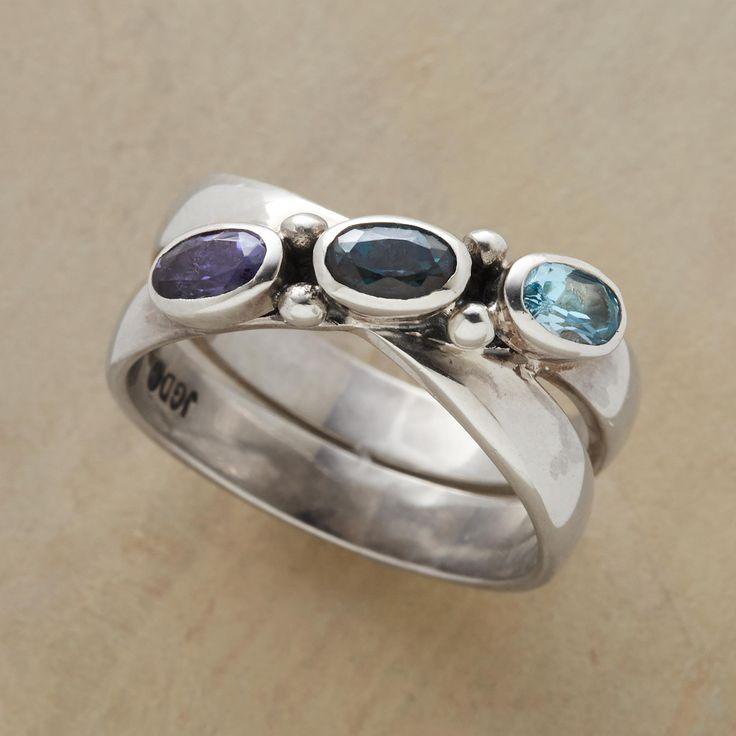 TRUE BLUES CROSSOVER RING -- Joined in back, our handcrafted true blues crossover ring in sterling silver splits to traverse itself in front. Topazes and an iolite stud the upper half. Exclusive. Whole sizes 5 to 9.