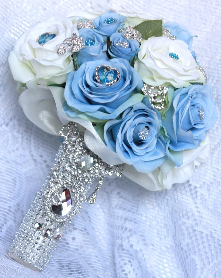 Cinderella Brooch Bouquet by http://couturekeepsakes.com/ use purple flowers
