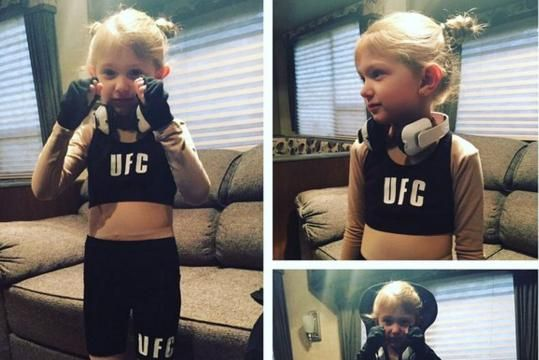 She probably doesn't pack as much of a punch just yet, but this little girl should be the undisputed costume contest champion.  Yes, she is dressed like  Ronda Rousey  for Halloween—trademark pigtail buns, walkout hoodie and all... #WMMA #rondarousey #halloween