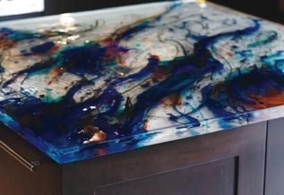 ThinkGlass has unleashed the potential for creative inspiration in the kitchen with their Artistic Glass Countertops. From shimmery hues reminiscent of the ocean to the bold splashes and streaks of a more contemporary mind, the possibilities for creating a truly custom one-of-a-kind countertop are limitless. ThinkGlass countertops are made from 100 percent recyclable glass. They are as strong and durable as natural stone and have a textured finish that hides fingerprints, resists scratches…