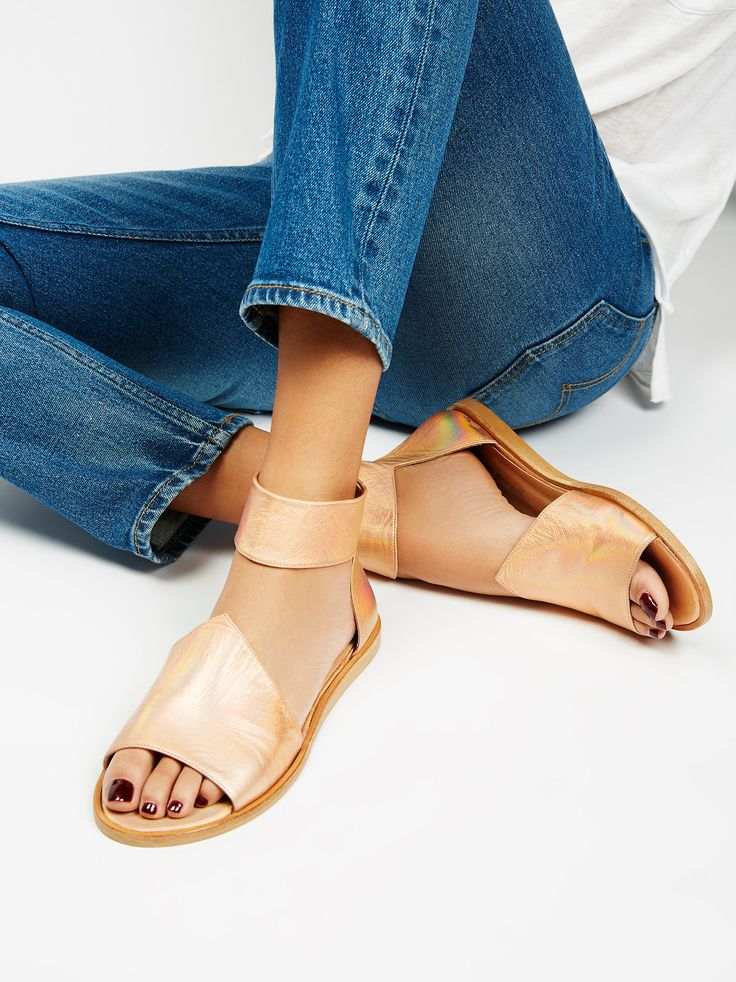 Elixir Sandal   Timeless leather sandal featuring a modern shape on the top of the foot with a wide ankle strap detail. * Back zipper closure * Padded footbed