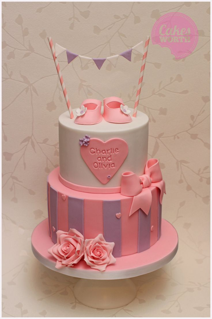 2 tier Christening cake for twin girls in pinks and purples with edible baby shoes, hearts, roses, bows and bunting. x