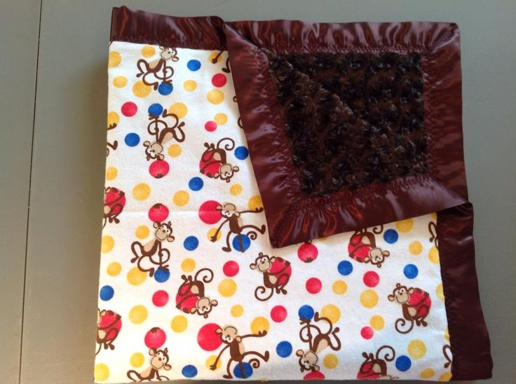 monkeys with red blue and yellow dots. brown rose and brown trim. 36x36""