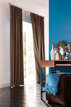 Formal or fun. Custom drapes are a decorator's secret weapon when setting a mood.  Photo courtesy of Budget Blinds