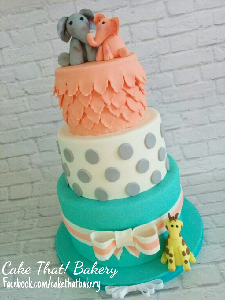 Teal and coral baby shower cake                                                                                                                                                                                 More