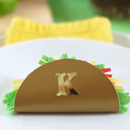 Surprise your guest with a mini taco place card filled with treats at your next fiesta.