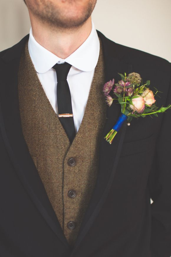groom with a tweedy vest and a hint of blue
