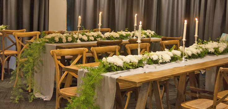 rustic wooden trestle tables and timber cross back chairs, long blue grey natural linen table runners at this beautiful semi cocktail wedding at The Anchorage, on the waterfront, port stephens