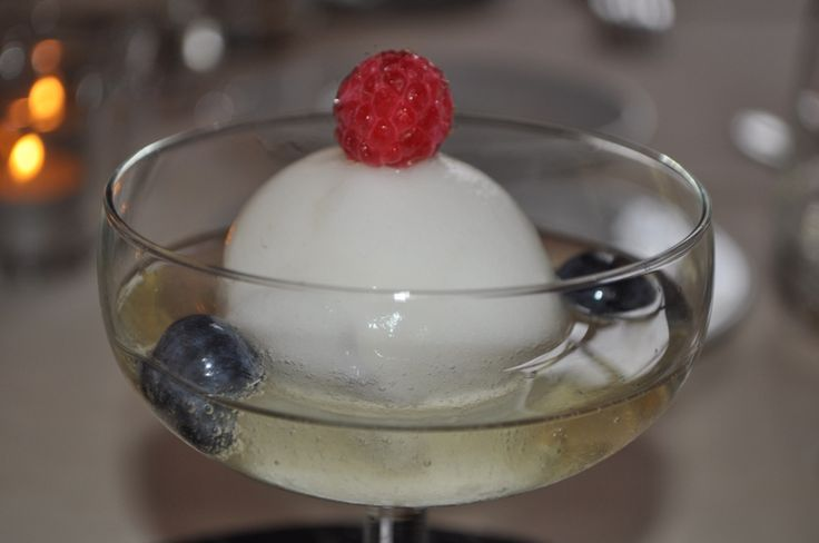 Champagne with ice cream, blueberry and red raspberry