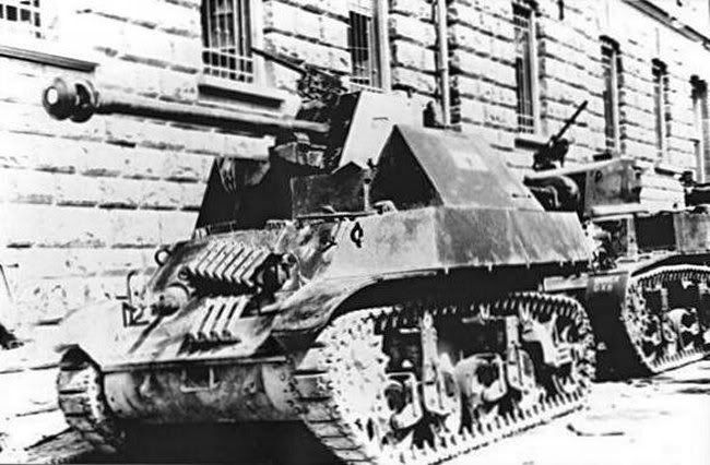 Captured M3 with a german Pak mounted, rare.