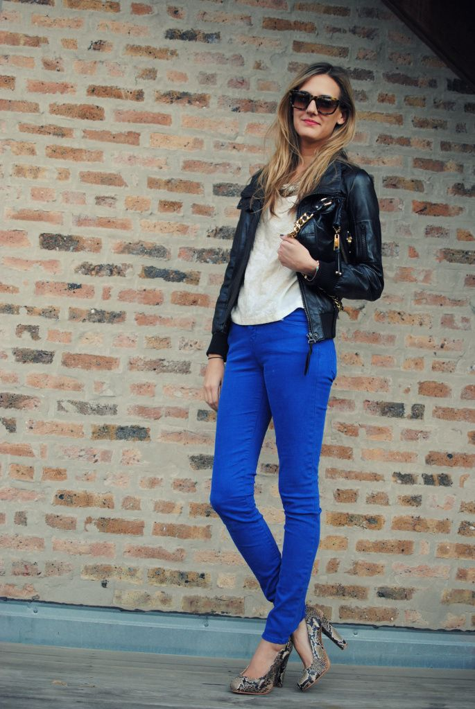 Electric blue skinny jeans plus leather jacket and python heels. RIght on. Love it.