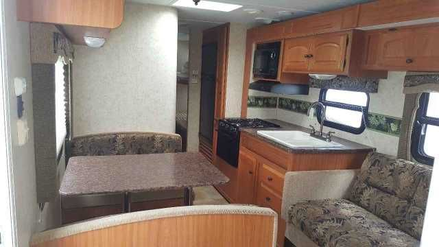 "2011 Used Thor Motor Coach Four Winds 291BHGS Travel Trailer in Georgia GA.Recreational Vehicle, rv, 2011 Four Winds RV Model # M-291BHGS with less than 10,000 miles. Perfect condition, Central A/C and Heating, Microwave, Gas Grill Cook Top, 15"" Flat Screen TV, DVD Player, Slideout w/ Awning, Queen Bed in Front w/ Memory Foam, 4 Upgraded Bunk Beds In Rear, Sofa and Dinette Both Fold Into Beds, All New Tires, Great Storage Space, All Hoses and Weight Distribution Tow Adapters Included, Anti…"