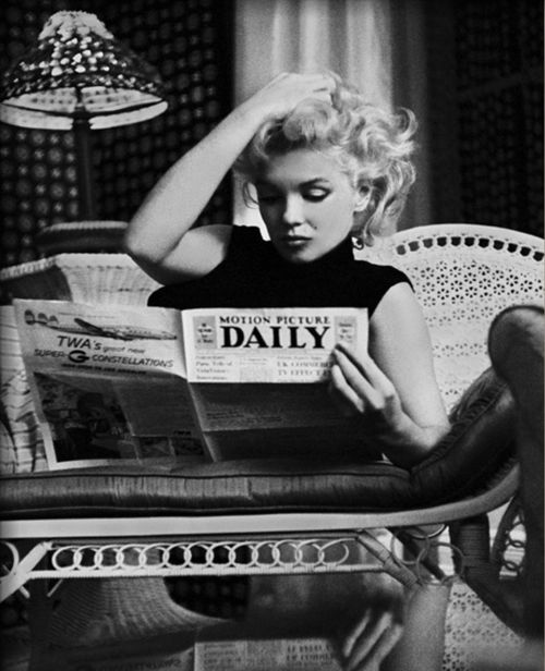 "Marilyn Monroe reading ""Motion Picture Daily"":"
