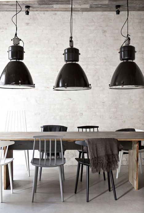 Norm Architects of Denmark collaborated with Danish designers Menu to create rustic Scandinavian dining rooms at Höst, a new restaurant in Copenhagen. The designers combined traditional Scandinavian cosiness with minimalism using industrial pendant lights, woollen blankets and reclaimed wood.