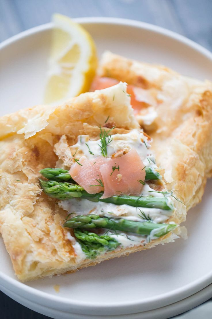 This recipe for asparagus and smoked salmon tart is impressive yet simple! This light and flaky dish is an elegant and tasty dish that is perfect for spring! via @Lemonsforlulu