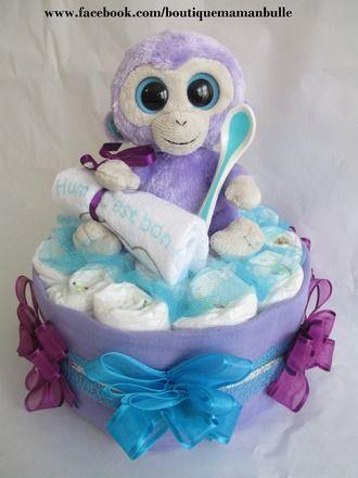 Cadeau iéal et original pour une naissance ou babyshower  Ce gâteau est composé de : - 19 couches taille 3 - d'1 lange de couleur mauve - 1 petit peluche singe - 1 bavoir  - 5536085